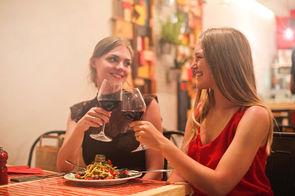 Ladies enjoying Wine and food in a restaurant