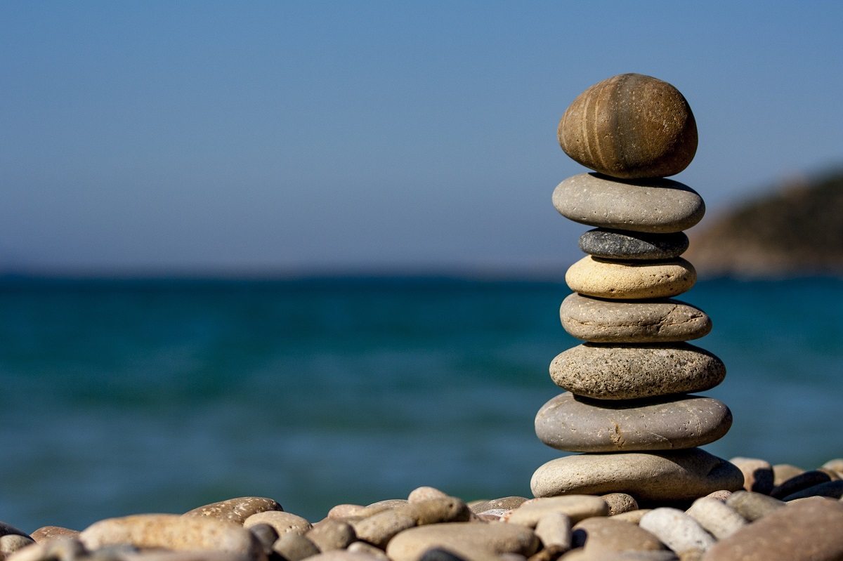 Stacked stones near the sea shore to symbolize the balance of life
