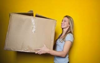 women holding the box while moving